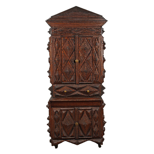 A 19th century carved wood Tramp Art cupboard.