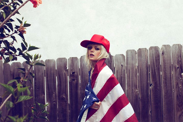 Australian Fashion Model Kara Searle photographed by Ameircan Photographer Zoey Grossman wearing an American Flag Cape.