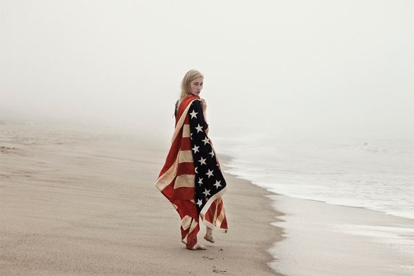 Girl on the beach with American Flag Cape photographed by Lauren Ward.