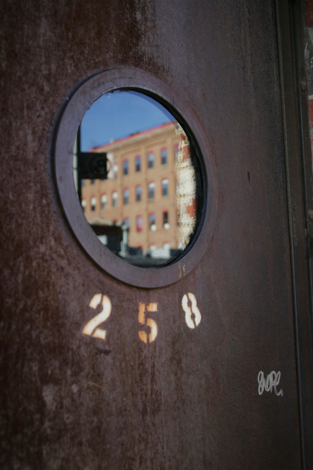 A rusty metal graffiti door in Williamsburg Brooklyn.