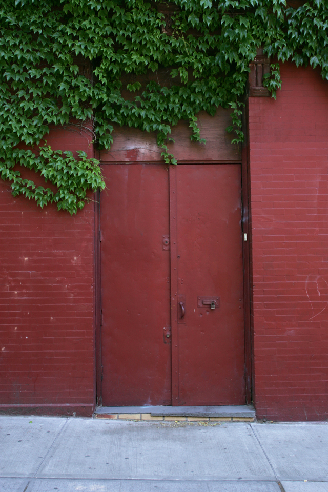 Painted red industrial door in Williamsburg Brooklyn.