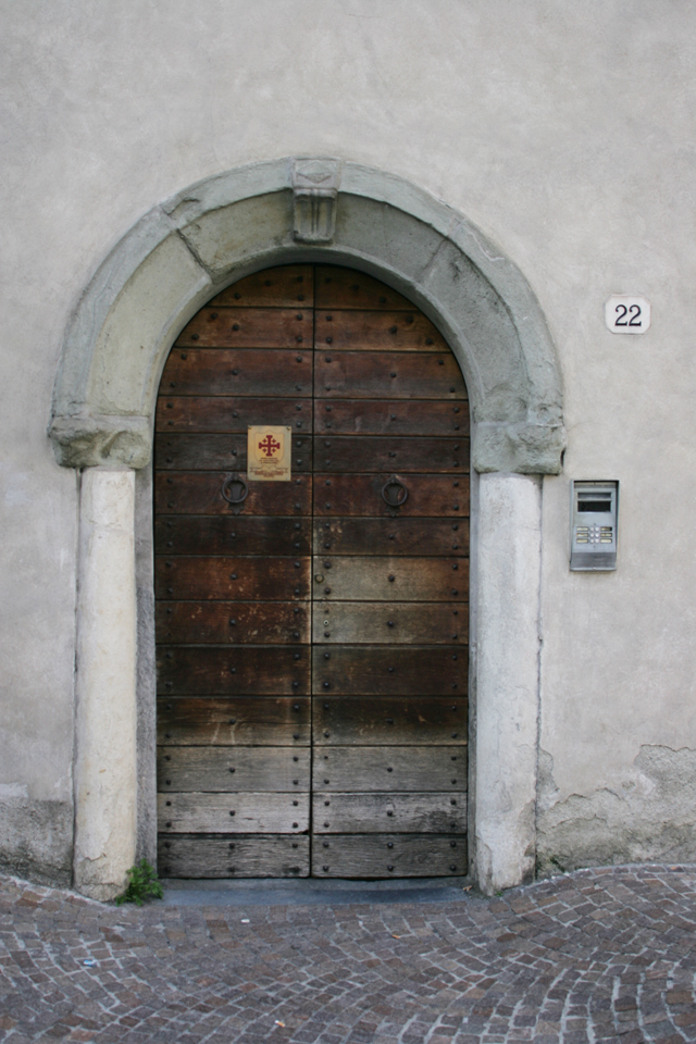 Antique wood church door in Como, Italy.