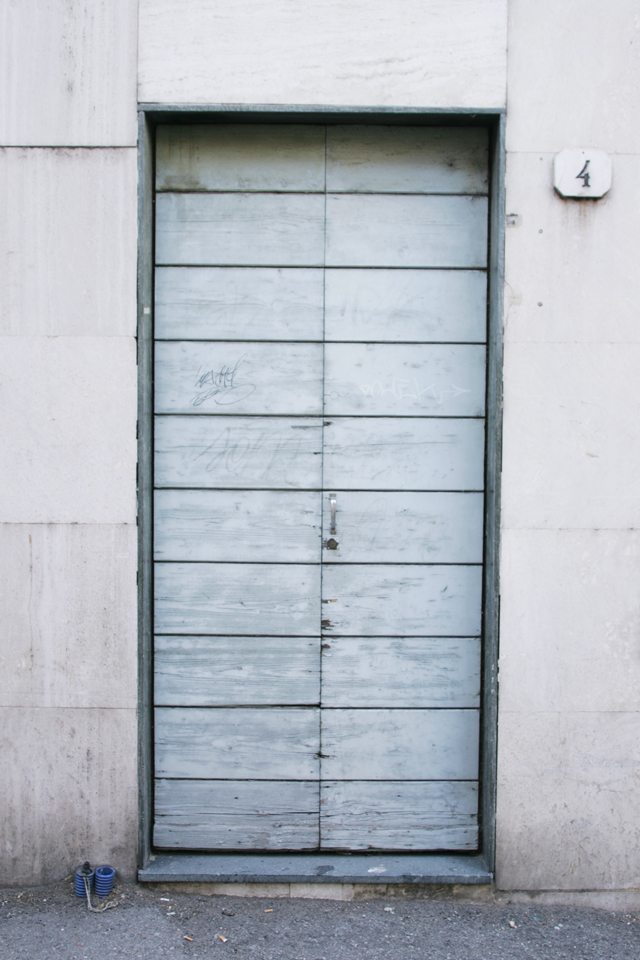 Italian, painted grey, wood graffiti door.