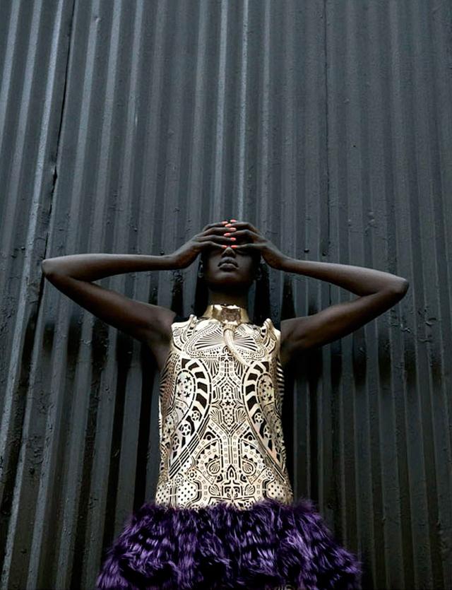 Fashion model Ajak Deng wearing Chanel, Balmain, Prada and Balenciaga with techno chic accessories.