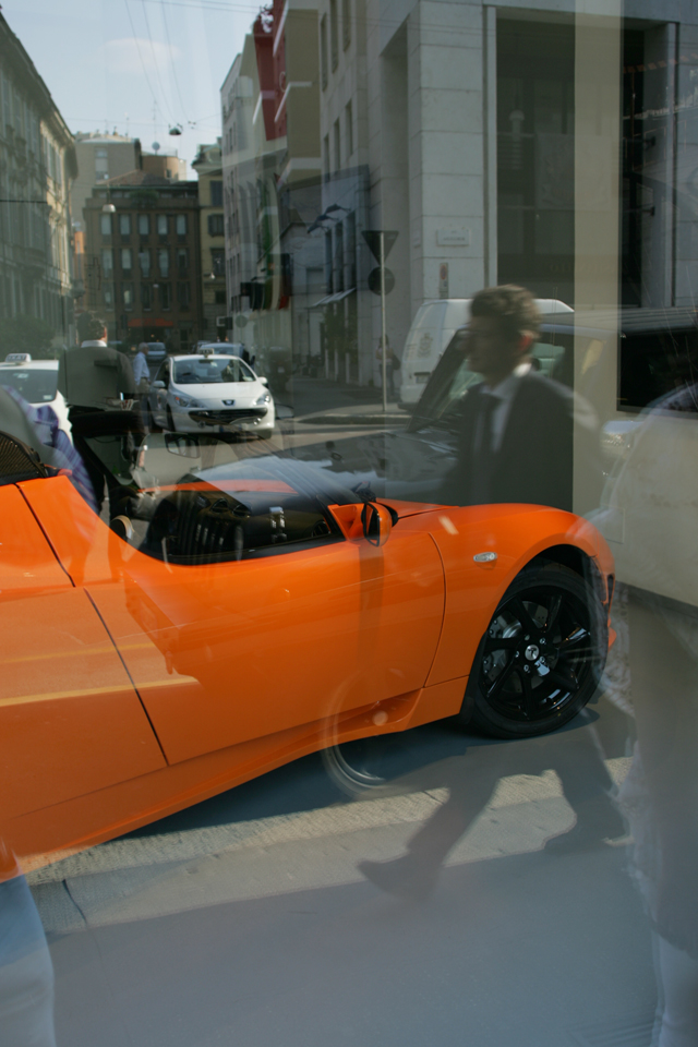 Neon orange sports car in Milan Italy.