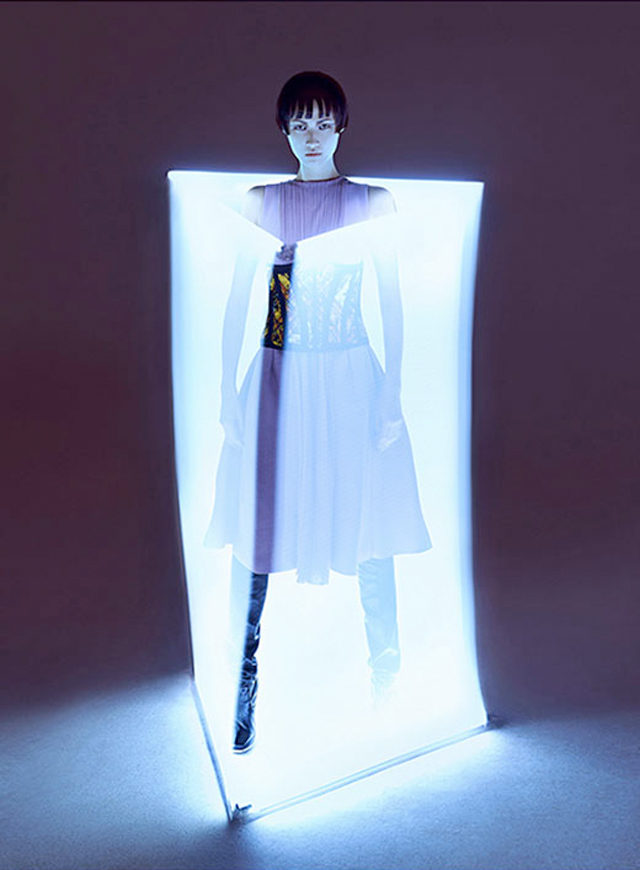 Charles Guo photographs model Wang Xiao wearing Tron inspired futuristic fashion.