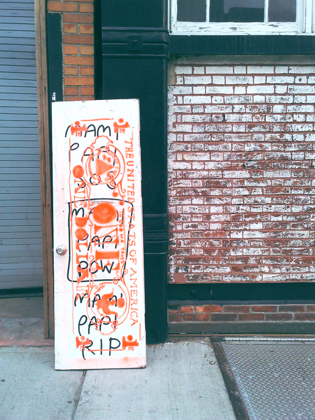 A graffiti covered door in Williamsburg, Brooklyn.