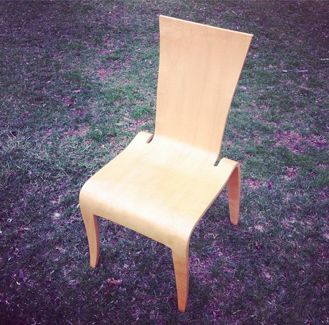A vintage post modern form molded plywood chair.