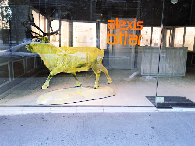 A neon yellow moose at the Madison Avenue, NYC Alexis Bittar window.