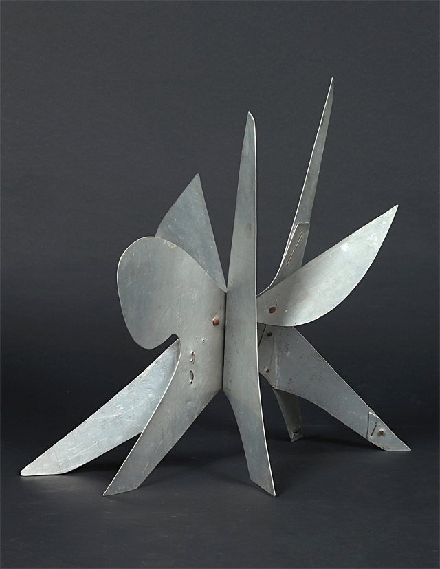 A mid-century sheet metal modern sculpture by American artist and Sculptor Alexander Calder.